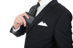 Biznesmena kładzenia portfel w jego kieszeni Zdjęcia Stock