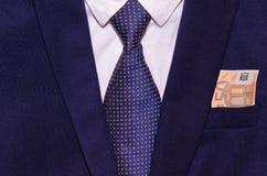 Biznesmena kostium z pieniądze w kieszeni Zdjęcia Stock