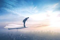 Biznesmena latanie na papierowym samolocie Zdjęcia Royalty Free