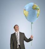 Biznesmena mienia balon z wizerunkiem obrazy stock