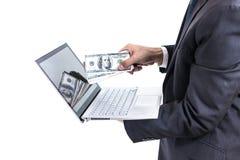 Biznesmena mienia banknotów Dolarowy rachunek komputer lub laptop Obrazy Stock