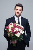 Biznesmena mienia kwiaty Obrazy Royalty Free