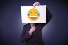 Biznesmena mienia papier z roześmianym emoticon Obrazy Royalty Free