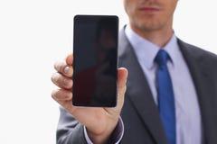 Biznesmena mienia smartphone w ręce Zdjęcia Royalty Free