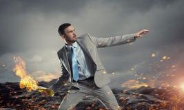 Biznesmena miotania koktail mołotowa Mieszani środki Obraz Royalty Free