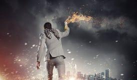Biznesmena miotania koktail mołotowa Mieszani środki Zdjęcie Stock