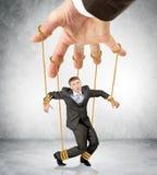 Biznesmena obwieszenie na sznurkach jak marionetka Obraz Royalty Free