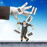 Biznesmena obwieszenie na sznurkach jak marionetka Fotografia Stock