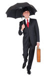 Biznesmena odprowadzenie z parasolem Zdjęcie Royalty Free