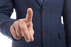 Biznesmena palec wskazujący dotyka niewidzialnego przejrzystego ekran obrazy stock