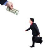 Biznesmena pościg ludzie z pieniądze metaforą Zdjęcie Royalty Free