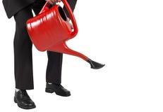 Biznesmena podlewanie z czerwienią może Obraz Stock