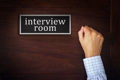 Biznesmena pukanie na wywiadu pokoju drzwi Obraz Royalty Free