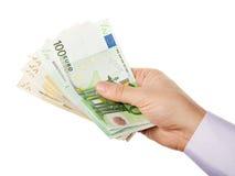 Biznesmena ręki mienia wiązka pieniądze Obrazy Royalty Free