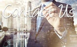 Biznesmena writing kontakt My na wirtualnym ekranie za plecy zdjęcie royalty free