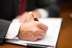 Biznesmena writing na jego agendzie Zdjęcie Stock