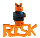 Biznesmena zarządzanie ryzykiem i świnia Zdjęcie Stock
