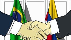 Biznesmeni lub politycy trząść ręki przeciw flaga Brazylia i Kolumbia Oficjalny spotkanie lub współpraca odnosić sie royalty ilustracja