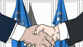 Biznesmeni lub politycy trząść ręki przeciw flaga Narody Zjednoczone Oficjalny spotkanie lub współpraca odnosić sie ilustracja wektor