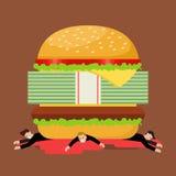 Biznesmeni pod hamburgeru kryzysem Fotografia Royalty Free