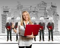 biznesmeni przewodzą laptop lampowej kobiety Zdjęcia Stock
