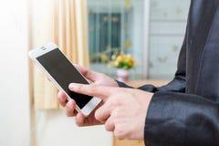 Biznesmeni używa twój telefon Obrazy Royalty Free