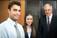 Biznesmeni w ich biurze Fotografia Royalty Free