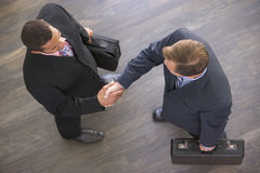 biznesmeni wydadzą w dwóch się Zdjęcie Stock