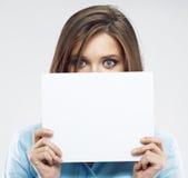 Biznesowa kobieta chuje twarz za sztandarem Obraz Royalty Free