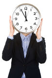 Biznesowa kobieta chuje za dużym zegarem Zdjęcia Stock