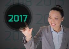 Biznesowa kobieta dotyka 2017 w cyfrowo wytwarzającym tle Zdjęcie Royalty Free