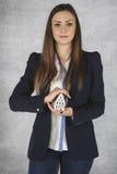 Biznesowa kobieta ochrania twój własność, ubezpieczenie Zdjęcie Stock