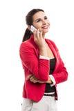 Biznesowa kobieta opowiada przy telefonem Fotografia Royalty Free