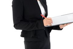 Biznesowa kobieta przegląda raport odizolowywającego na bielu Zdjęcie Royalty Free