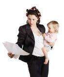 Biznesowa kobieta trzyma dziecka. Odizolowywający nad bielem obraz royalty free