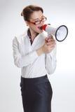 Biznesowa kobieta w biurze z megafonem zdjęcie royalty free