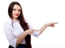 Biznesowa kobieta wskazuje jej palec przeciw someone Fotografia Royalty Free