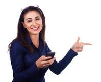 Biznesowa kobieta wskazuje stronę na bielu obraz stock