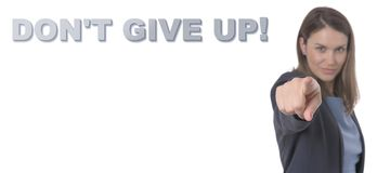 Biznesowa kobieta wskazuje teksta DON ` T DAJE UP! POJĘCIE biznes zdjęcia stock