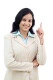 Biznesowa kobieta wskazuje up przeciw bielowi obrazy stock