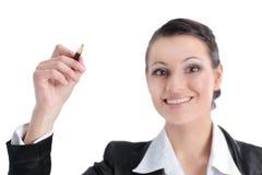 Biznesowa kobieta wskazuje z ołówkiem przy wirtualnym punktem zdjęcia stock