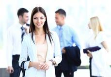 Biznesowa kobieta z jej drużyną Zdjęcia Stock