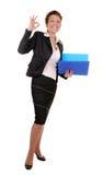 Biznesowa kobieta z raportami i ok gestem Obrazy Royalty Free