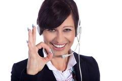 Biznesowa kobieta z słuchawki Zdjęcia Royalty Free