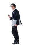 biznesowa laptopu mężczyzna telefonu pozycja Fotografia Stock