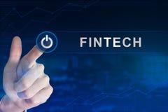 Biznesowa ręka klika fintech lub pieniężnego technologia guzika Obrazy Royalty Free