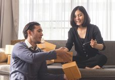 Biznesowego życia partnera kocowania pudełka dla online sklepowej dostawy Obraz Royalty Free