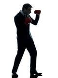 Biznesowego mężczyzna bokser z bokserskich rękawiczek sylwetką Fotografia Stock