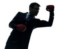 Biznesowego mężczyzna bokser z bokserskich rękawiczek sylwetką Obrazy Stock