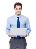 Biznesowego mężczyzna chwyt z laptopem Zdjęcia Stock